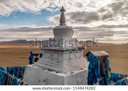 White Buddhist Stupa on Steppes of Mongolia. #1148474282