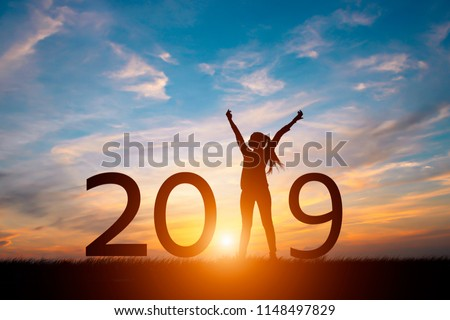 Silhouette of happy woman with New year 2019 concept in sunset background. #1148497829