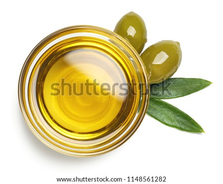 Bowl of fresh extra virgin olive oil and green olives with leaves isolated on white background. Top view #1148561282