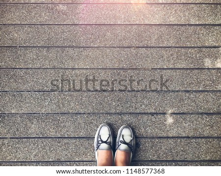 Top view of selfie feet on gray floor background, decision making , Choices concept, where to go, directions, business solutions #1148577368
