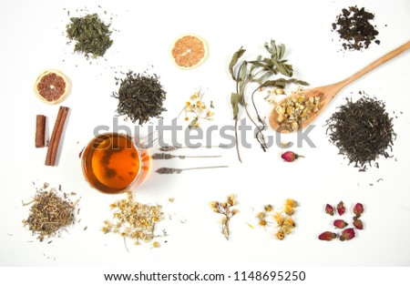 dry tea and herbs scattered on a white background  #1148695250