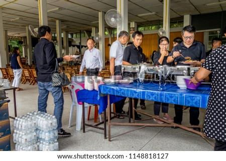 Chiang Rai THAILAND:8:1:2018 unidentified Thai people participating traditional buddhist funeral on:8:1:2018 in Chiang Rai , Thailand. #1148818127