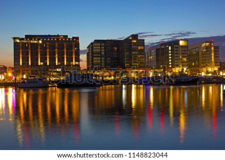 The Wharf district residential buildings with marina at dawn. The Wharf of Washington DC with waterfront and its colorful reflection in Potomac River. #1148823044
