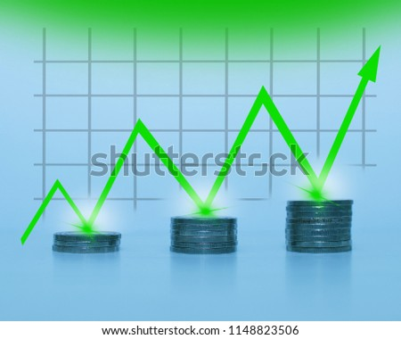 Coin stack with financial graph. Growth with green arrow and copy space for financial and business concept