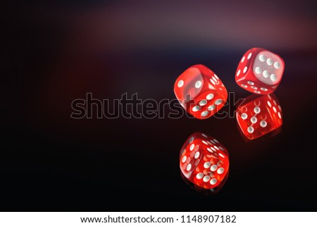 The dice fall on a dark red background. Soft tinted image. Casino gambling poker, roulette. Royalty-Free Stock Photo #1148907182