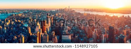 Amazing aerial panoramic view of Manhattan wit sunset #1148927105