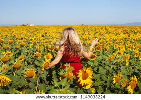 happy woman in summer sunflower field enjoying life, natural beauty #1149033224