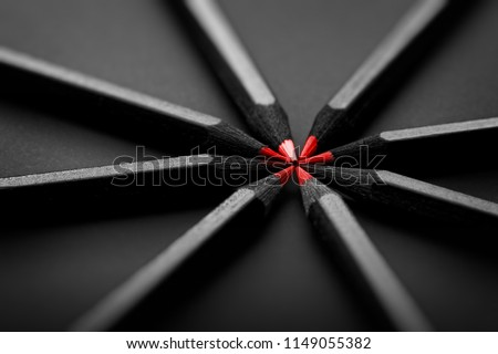 Red and black colored pencils. stylish business concept, on black background