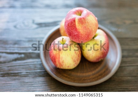 Red yellow apples in rustic style #1149065315