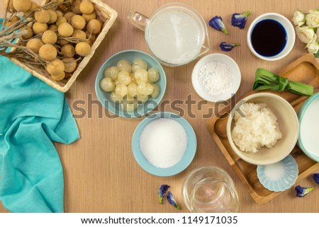 Sticky rice boiled in syrup with longan and coconut milk dressing. Thai dessert #1149171035