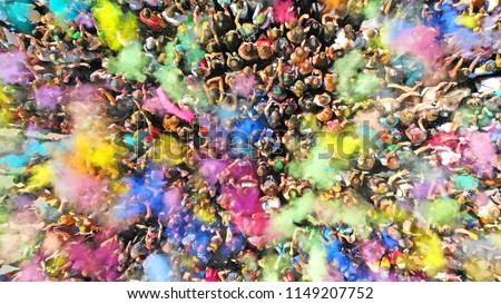 Aerial top view of a Holi Colors Festival. Splash of paint in a crowd of people view above.  #1149207752