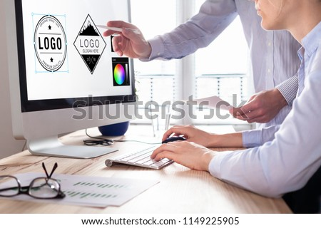 Designer team sketching a logo in digital design studio on computer, creative graphic drawing skills for marketing and branding #1149225905