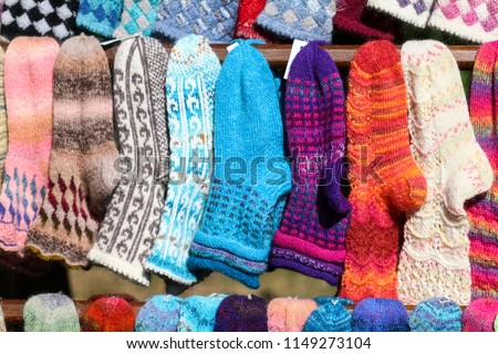 Products made of yarn knitted socks showcase with knitted socks on the market #1149273104