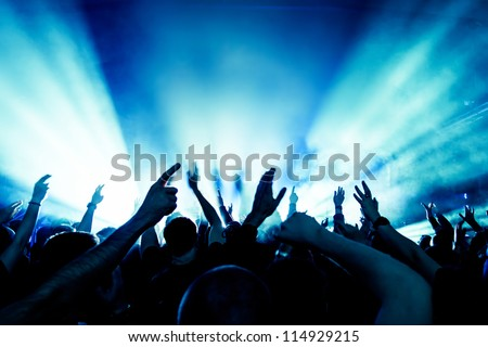 cheering crowd in front of bright stage lights #114929215