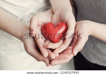 Young woman holding red heart, health insurance, donation, happy charity volunteer concept, world health day, world mental health day, world heart day #1149357995
