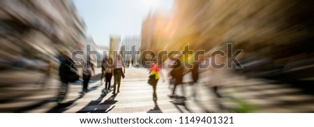 Crowd of anonymous people walking on busy city street #1149401321