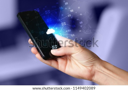 Hand using phone with cloud computing and online storage concept #1149402089
