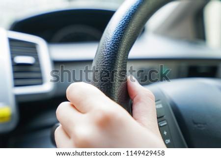 Woman driving a car #1149429458