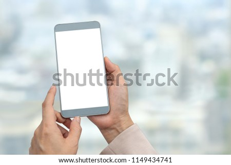 People using a smartphone in the abstract blurred background with clipping path on the screen. Blank screen for graphics display montage. #1149434741