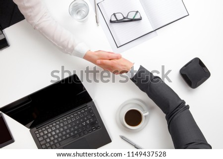 Business People Shaking Hands At Office Desk #1149437528