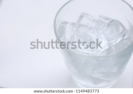 Glass with ice cubes on white background, ice in clear glass,Glass with ice isolated on white background, top view #1149483773