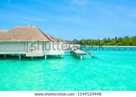 Lhaviyani Atoll, Maldives - 12 July 2018: Beautiful landscape of over water villas in luxury hotel, Kanuhura island #1149529448