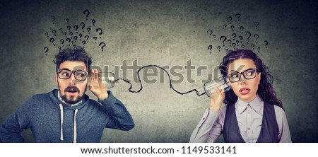 Funny looking man and woman having troubled communication #1149533141