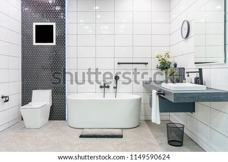 Modern bathroom interior with minimalistic shower and lighting, white toilet, sink and bathtub #1149590624