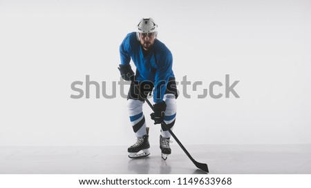 Portrait of Caucasian male ice hockey player in uniform posing against white background #1149633968