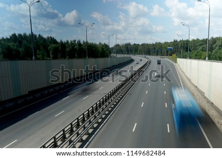 Multi-lane highway with cars traveling at high speed. #1149682484