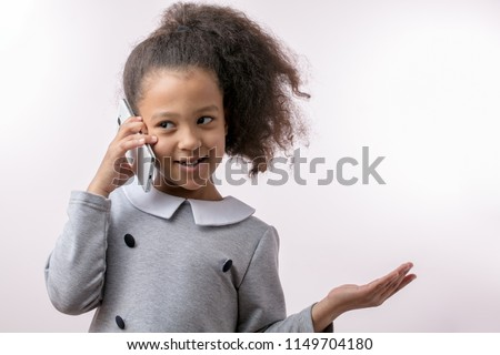 positive little girl using cell phone. phone conversation. copy space. free time. entertainment #1149704180