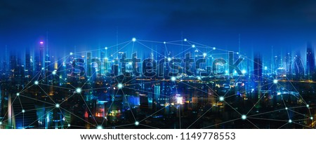 Wireless network and Connection technology concept with Bangkok city background at night in Thailand, panorama view Royalty-Free Stock Photo #1149778553