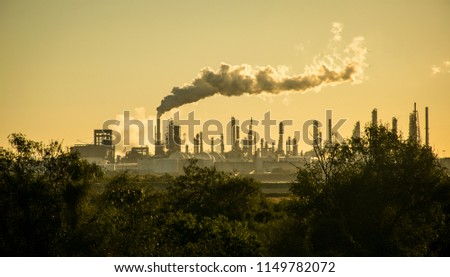 Deadly Future Smoke Stack Oil Refinery Carbon Pollution and Climate Change. Global warming and the destruction of our environment in Corpus Christi , Texas , USA #1149782072