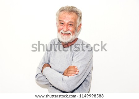 Portrait of happy smiling senior man looking at camera while standing on white background #1149998588