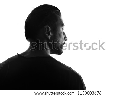 Male person silhouette,back lit over white #1150003676