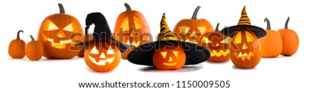 A collection of Jack O Lantern Halloween pumpkins with various different designs and witches hat in a row isolated on white background #1150009505