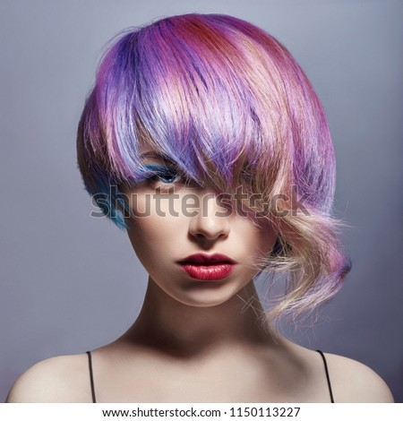Portrait of a woman with bright colored flying hair, all shades of purple. Hair coloring, beautiful lips and makeup. Hair fluttering in the wind. Sexy girl with short  hair. Professional coloring #1150113227