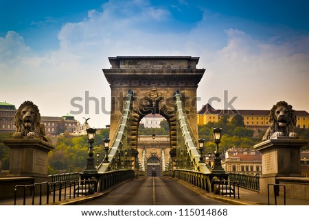 The Szechenyi Chain Bridge is a beautiful, decorative suspension bridge that spans the River Danube of Budapest, the capital of Hungary. Royalty-Free Stock Photo #115014868