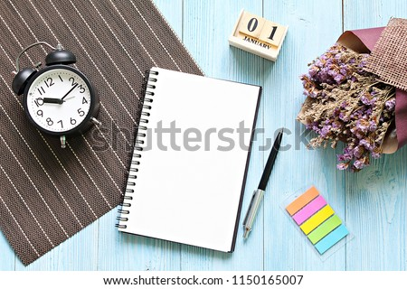 Business, still life, working, holiday or new year planning concept : Desk table with open notebook paper, cube calendar and clock, Top view or flat lay with copy space ready for adding or mock up #1150165007