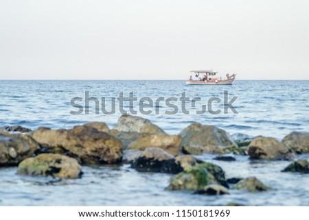 Fishing boat on the high seas in Leptokaria Greece  #1150181969