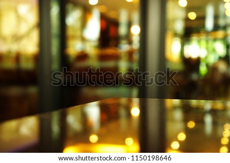 corner of table reflection night light with blur background of pub or bar  #1150198646