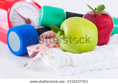 Dumbells with measuring tape and apples #1150237355