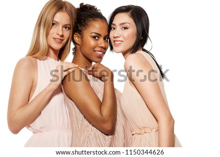 Portrait of mixed races young women sweetly smiling and looking with flirt at camera. Friendship of different nationalities concept. Isolated on white background #1150344626