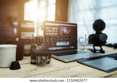 The accessories gear for Youtuber creative and Vlogger editor in house office the laptop Lens Camera and Drone And for editing video upload to internet.