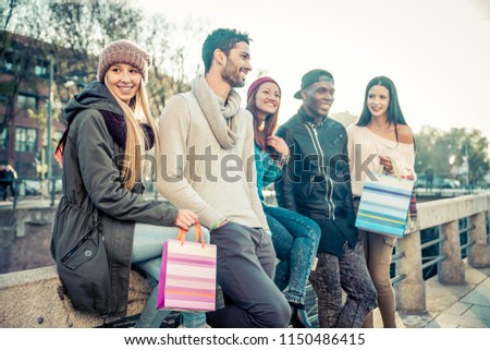 Group of multi-ethnic friends walking on the streets and smiling - Young people having fun outdoors #1150486415