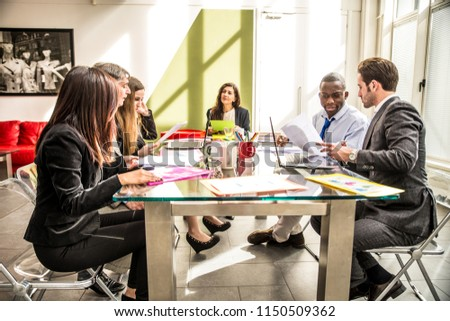 Business people at work in the office - Business meeting in a start up #1150509362