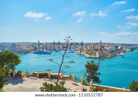 The view on Fort Saint Angelo in Birgu (Vittoriosa), fortress of Senglea (L-Isla), Valletta Grand Harbour and the scenic terrace of Herbert Ganado Gardens with agave plant on the foreground, Malta. #1150552787