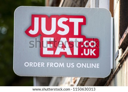 COVENTRY, UK - JULY 26TH 2018: A Just Eat sign outside a takeaway restaurant in the city of Coventry, UK, on 26th July 2018. #1150630313