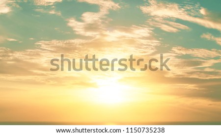 Good morning sunrise or sunset evening sky background with cloud and early sun rising over water ocean sea horizon skyline for early bird, beginning new day, June sun solstice, holiday vacation #1150735238