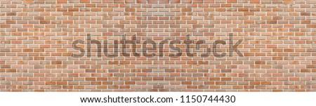 Panoramic red orange old brick wall pattern texture background. Wide panorama of masonry #1150744430